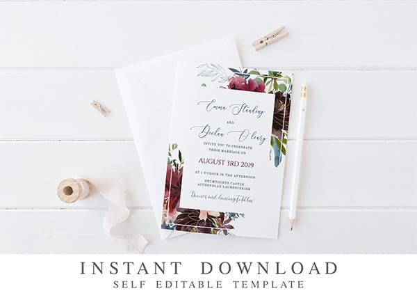 image of wedding invite on white background with white pencil and ribbon