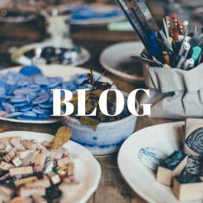 Image of blue art items with Blog in writing on it